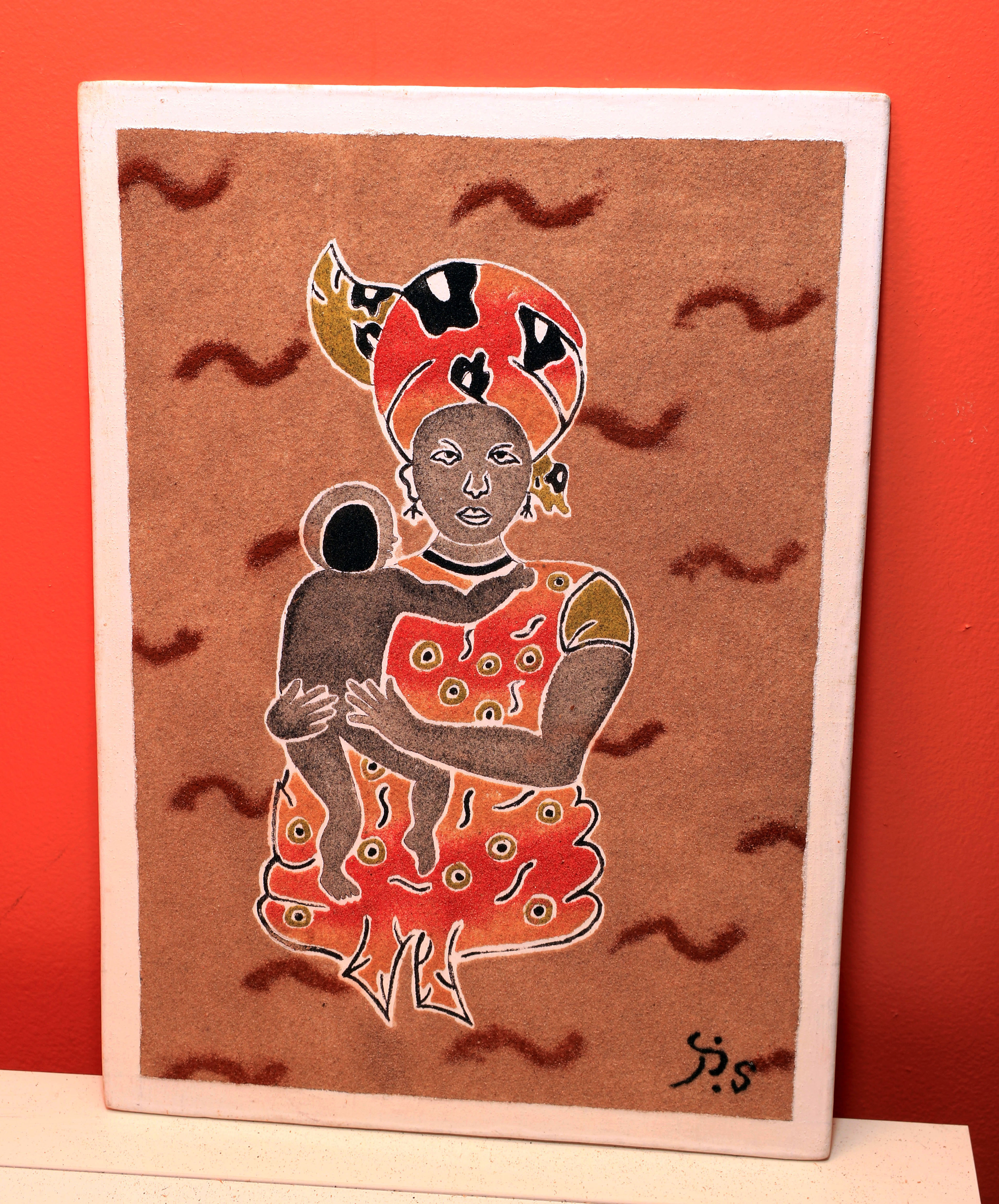 African Mother holding Child - Sand Painting